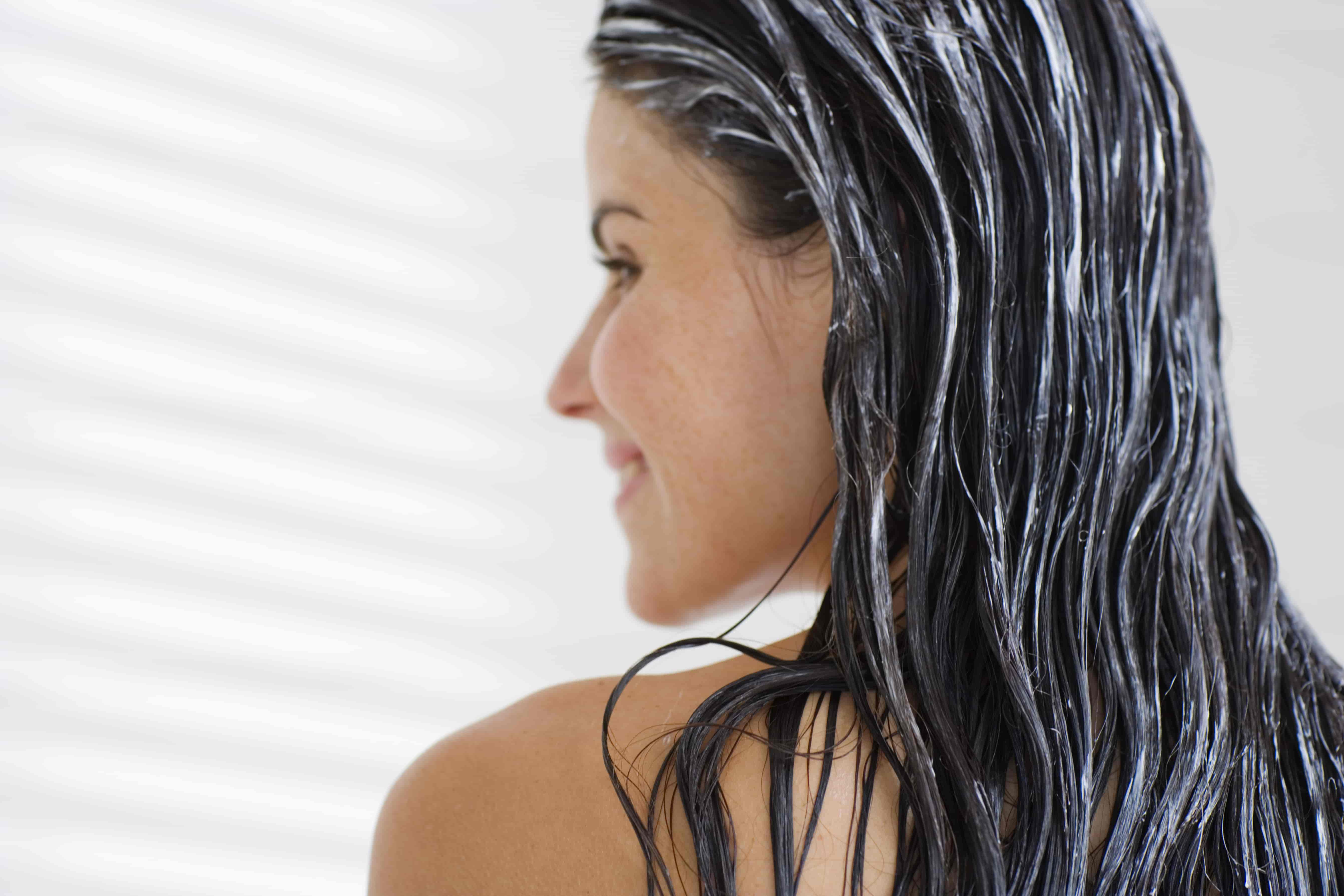 woman with conditioner on her hair