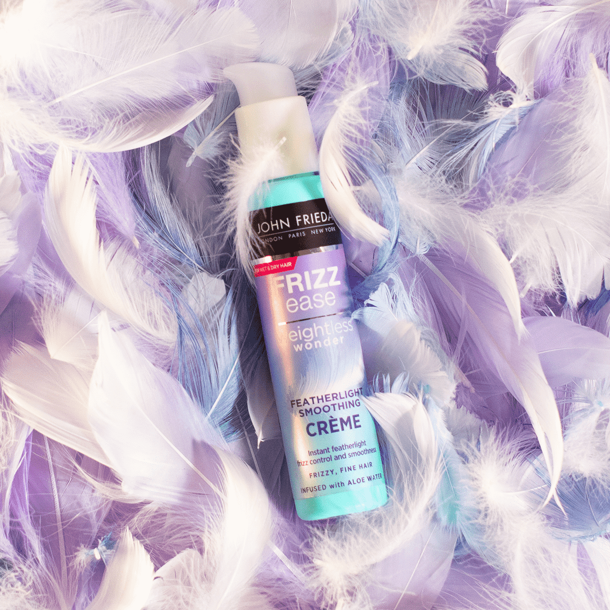 John Frieda creme surrounded by feathers