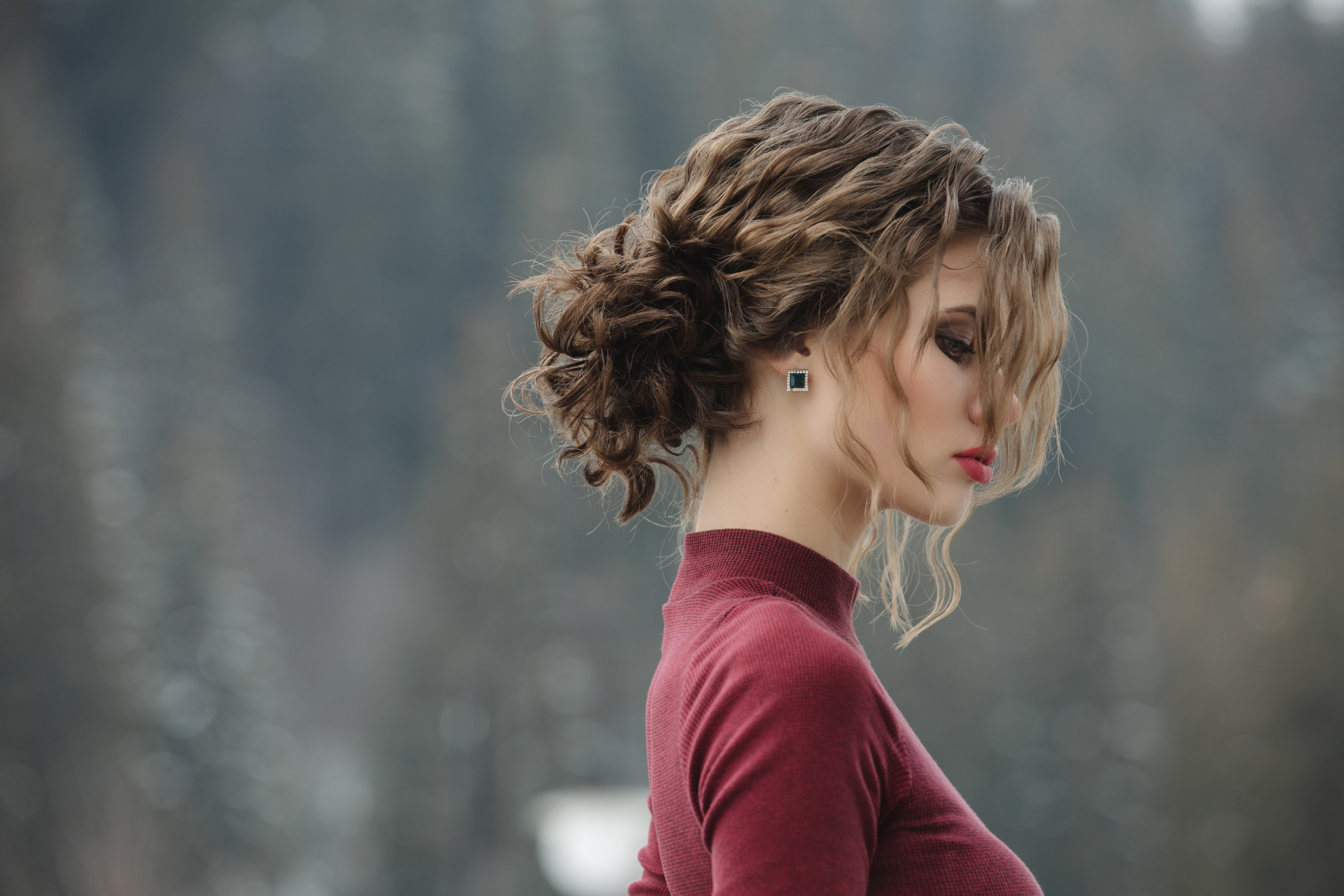 Woman with curly hairstyle at winter